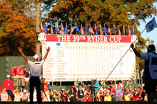 Martin Kaymer of Europe celebrates after making the winning putt as his caddie Craig Connelly watches on the 18th green to win The 39th Ryder Cup. Photo / Getty Images.