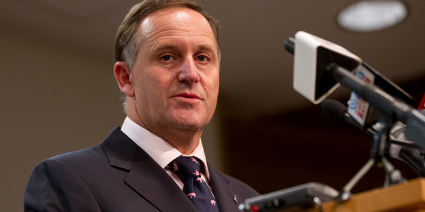 Prime Minister John Key says the Govt is still on track to reach surplus by 2014/2015. Photo / NZ Herald