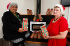 Te Whare Tiaki Wahine Refuge manager Caroline Herewini (left) and Women's Refuge chief executive Heather Henare preparing gifts for the families who will stay with them at Christmas.  Photo / Mark Mitchell