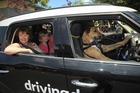 Dinah Towle and Lucy Sharp take a turn in the SPCA car being driven by Porter. Photo / Jason Dorday