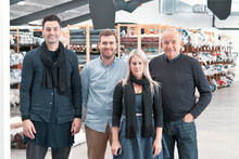 The team at Wall Fabrics - Des, Nick, Kate, and Roger Wall - are a big part of the reason many labels are in business.