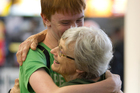 A hug for Cynthia Landels from grandson Mikael Landels, whom she hasn't seen for three years, after his arrival from Sweden. Photo / Steven McNicholl