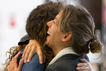 Dorica Aponte embraces her sister Alex after her long flight from Puerto Rico. Photo / Steven McNicholl