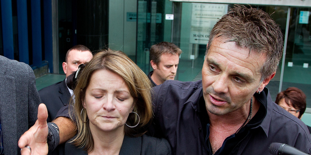 Sue Hollows and her husband, Heath, speak of their anguish outside the court. Photo / Marty Melville