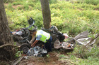 Police investigate the scene of a fatal crash where five were found dead. Photo / Christine Cornege