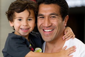 Mils Muliaina, with son Max in Auckland yesterday, is a star in Japan despite a string of losses. Photo / Sarah Ivey
