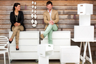 Janice Kumar-Ward and her husband Julian with some of their custom-made furniture. Photo / Babiche Martens