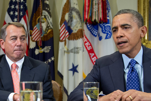 Speaker of the House John Boehner (left) and President Barack Obama are working to avert the fiscal cliff. Photo / AP