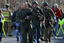 Heavily armed state troopers were sent to the Sandy Hook school