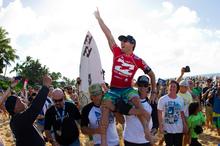 Joel Parkinson of Coolangatta, Australia, celebrates after winning his maiden ASP World Title. Photo / Association of Surfing Professionals