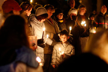 Mourners gather for a candlelight vigil at Ram's Pasture in Newtown to remember the Sandy Hook Elementary School victims. Photo / AP