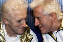 Jimmy Savile, right, posed with a wax work model at Madame Tussauds museum in London. Photo / AP