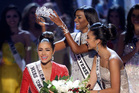 Miss USA, Olivia Culpo, left, is crowned Miss Universe during the Miss Universe competition in Las Vegas. Photo / AP
