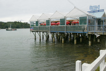 Mangonui's Fish Shop is perched over the bay. Photo / NZ Herald