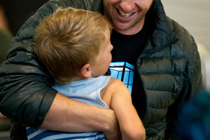Braith, 6, has a hug ready as his uncle Marc Checkley arrives from Singapore.  Photo / Dean Purcell