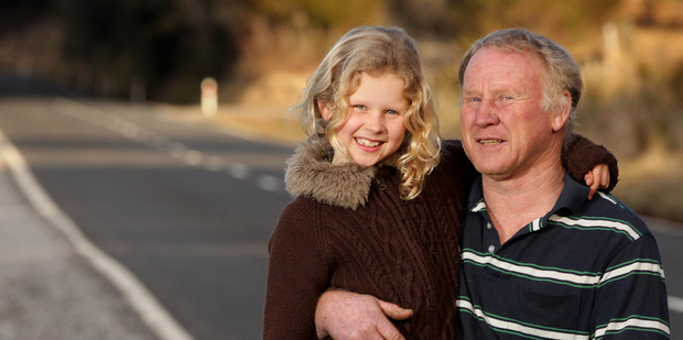 Michelle O'Brien, 8, and her father, Kevin O'Brien were the first on the scene of a fatal crash that killed three American tourists and injured four others when their van left the road. Photo / NZ Herald