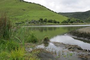 A 50-year-old man went missing after a morning swim at Lake Wainamu at Bethells Beach. Photo / File