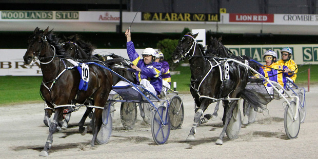 Smoken Up is first past the post in the Interdominion Grand Final from Themightyquinn at Alexandra Park. Photo / NZPA