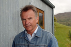 Sam Neill ... shy and charming, with a piglet. Picture / NZPA