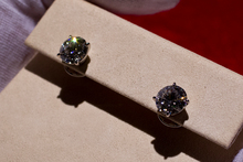 These flawless diamond earrings are meant to be kept in a safe. Photo / Sarah Ivey