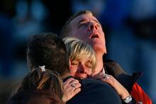 The families of victims grieve near Sandy Hook Elementary School. Photo / AP