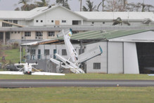 Planes parked at the Nadi International Airport blown away during the Tropical Cyclone Evan. Photo / Navneet Narayan