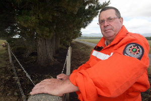Rural fire officer Porky Sexton at the scene of a blaze that broke out in a shelter belt of pines. Photo / Lynda Feringa