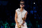 Justin Bieber performs during his Believe Tour. Photo/AP