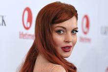 Lindsay Lohan on the red carpet for Liz & Dick. Photo/AP