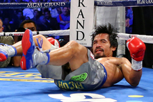 Going into the fourth instalment of the fierce, and utterly compelling Manny Pacquiao-Juan Manuel Marquez rivalry, fans knew they could once again expect something special. Photo / Getty Images.