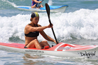Olympic kayaking champion Lisa Carrington, on her way to the open women's surf ski title at the 2011 New Zealand surf lifesaving championships in Mount Maunganui. Photo / Jamie Troughton