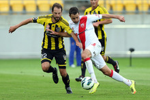 Andrew Durante of the Phoenix defends against Josip Tadic of the Heart during the round 13 A-League match between the Wellington Phoenix and the Melbourne Heart at Westpac Stadium. Photo / Getty Images