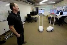 Bo Preising, Suitable Technologies' vice president of engineering talks to employees using a Beam robot. Photo / AP
