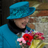 Britain's Queen Elizabeth II receives flowers from children after attending the British royal family's traditional Christmas Day church service in Sandringham, England. Photo / AP