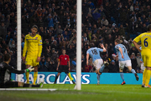 Manchester City's Gareth Barry, center, celebrates after scoring against Reading during their English Premier League s