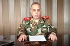 "Syria's military police chief has announced via an online video that he has defected from President Bashar al-Assad's regime, accusing the army of having turned into ""murderous gangs""."