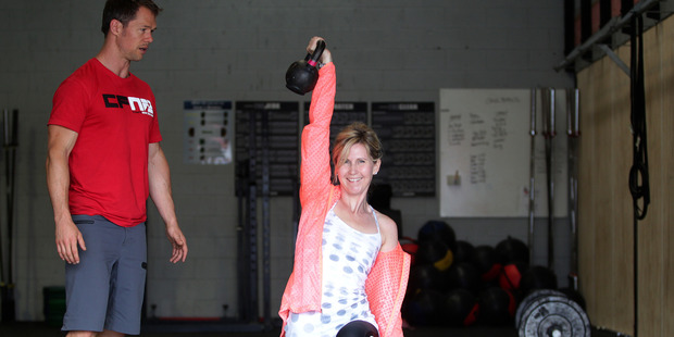 Rachel Grunwell tries CrossFit, an ever-changing workout that simulates functional but challenging movements useful in everyday life and can quickly become addictive. Photo / Doug Sherring