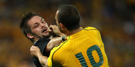 Brothers, not: Richie McCaw and Quade Cooper. Photo / Getty Images