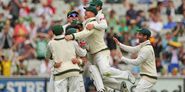 Australia celebrate after Mitchell Johnson dismisses Tillakaratne Dilshan. Photo / Getty Images