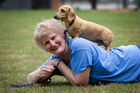 Auckland SPCA volunteer Liz Holdcroft gets down to earth with her miniature dachshund Gem. Photo / Sarah Ivey
