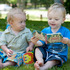 Cousins Ethan Curtis (18 months) and Max Addison (almost 1 year) know a thumping good read when they sit down with one at a family picnic in Cornwall Park, Auckland. Photo / Janet Currie