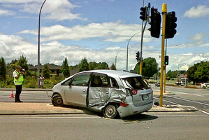 The car in which a 71-year-old woman died was pushed on to a traffic island when it and a four-wheel-drive vehicle collided. Photo / Natalie Akoorie
