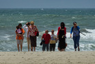 Visitors to the beach at Mt Maunganui yesterday were greeted by stormy seas and strong winds. Photo / Alan Gibson