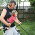 "Earmuffs on and set to go, 22-month-old Noah Falconer ""helps"" his daddy, Grant Falconer, mow the lawn. Photo / Trudy Renner Falconer"