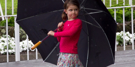 A little girl plays in the rain inbetween races at the Boxing Day Races at Ellerslie. Photo / Natalie Slade