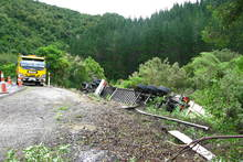 A 16-wheeler articulated lorry crashes 27km from Opotiki in the Waioeka Gorge. The driver escaped unhurt but the lorry was carrying sound equipment for the Rhythm and Vines music festival in Gisborne.