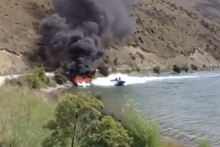 Screenshot from Youtube - Quick thinking by the driver of a speedboat put out fire on craft. Photo / Lukas Hayward