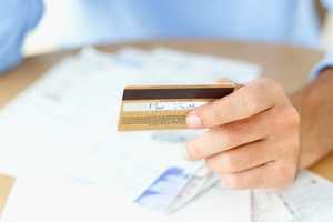 Make up your mind to avoid using your card for items you can well do without. Photo / Getty images