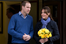 Prince William stands next to his wife Kate, Duchess of Cambridge as she leaves hospital.Photo / AP