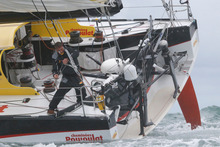 Swiss skipper Bernard Stamm sails after crossing the starting line of the Vendee Globe sailing race. Photo / AP